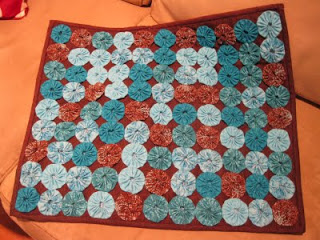 Lisa's Quilt: Brown and turqoise yo-yo